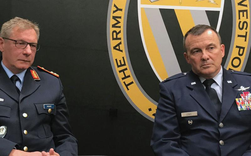 Maj. Gen. Wolfgang Renner (l), GEAF, commander, NATO CIS Group and deputy chief of staff cyberspace, SHAPE, and Col. Donald Lewis, USAF, deputy director, NATO CyOC, discuss the establishment of the alliance's cyber operations at the CyCon U.S. conference in November 2018.
