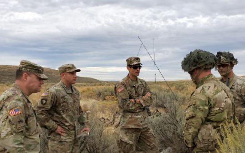 Lt. Col. Brian Wong, USA, chief of market research for the Army's Network Cross Functional Team (c), assesses the waveform strength of several mobile ad hoc network radio signals during a Rapid Innovation Fund capstone event in 2019 in Yakima, Washington. Engineers at Johns Hopkins' Applied Research Lab are looking into how to build a large scale network of intelligent radios, among other tactical communications efforts.    USA/PEO C3T Public Affairs
