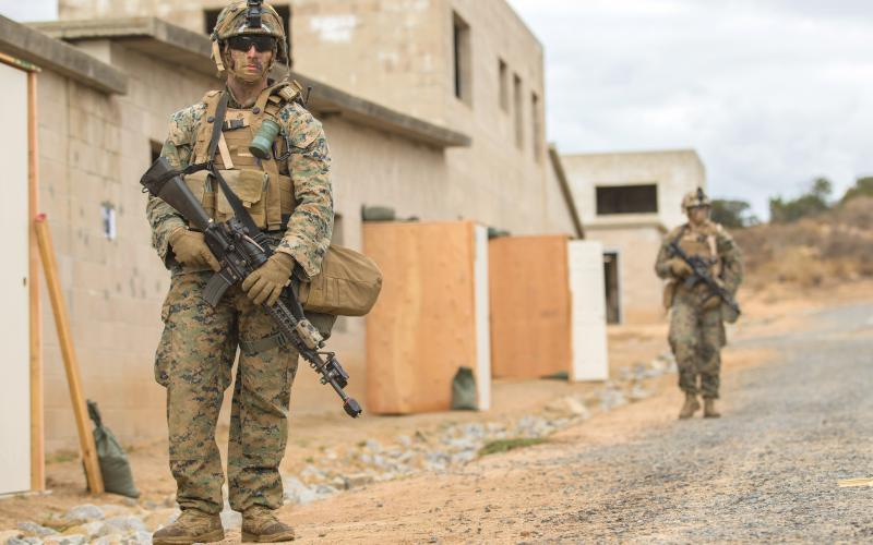 Lance Cpl. Nathan Long, USMC (l), of the 7th Engineer Support Battalion, 1st Marine Logistics Group, participates in a recent mock patrol during a military operation at Camp Pendleton, California. The Marine Corps is facing a changing operating environment and needs appropriate technologies to support urban warfare.