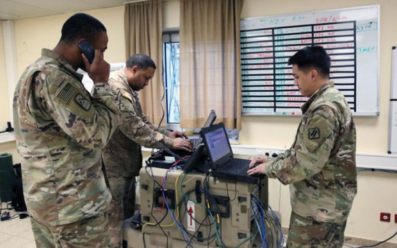 Three U.S. Army soldiers manage company network operations at Hohenfels Training Area in Germany. A key requirement for future Army networking is that command posts be mobile, agile and integratable. Army photography by William B. King