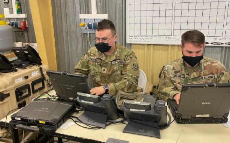 Sgt. Anton Mills, USA, senior transmission system operator-maintainer, and Spc. Ryan Frederick, USA, transmission systems operator maintainer, validate the hybrid in preparation for Dragoon Ready 2021.  Capt. Dallas R. Villarreal, USA