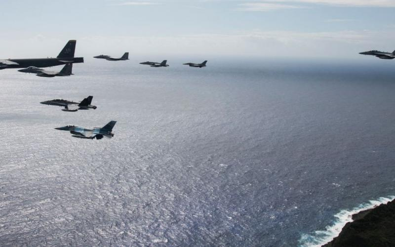 An eight-ship joint coalition formation flies over Andersen Air Force Base, Guam, during exercise Cope North 2020 in February 2020. Guam is proving to be a strategic hub for the United States' efforts in the Indo-Pacific region, the military's priority theater.  U.S. Air Force photo by Master Sgt. Larry E. Reid Jr.