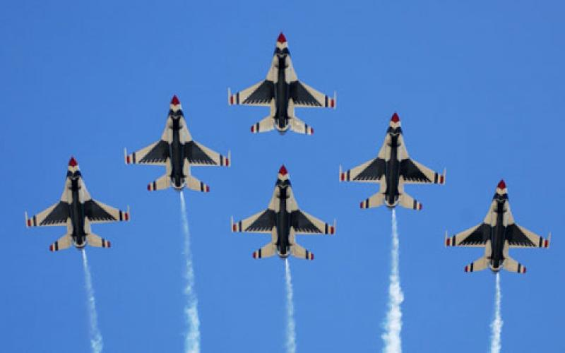 The U.S. Air Force Thunderbirds perform a six-ship formation flyover during an air show. Researchers want to know which indicators of personal performance—heart rate or body sway, for example—begin to synchronize when a team works well together.