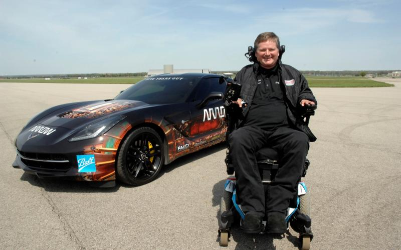 Sam Schmidt, former IndyCar driver, is stationed in front of a semiautonomous Corvette. One Air Force Research Laboratory team helped develop the interface that allowed Schmidt to control the car using head movements. Another team used sensors to monitor his performance during the man-and-machine collaboration project.
