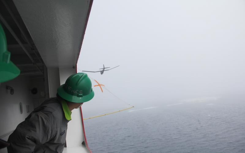 A net capture system is being evaluated to replace the need to recover unmanned aircraft, such as the Puma, from the cold Arctic waters. The aircraft encountered difficulties with maintaining GPS lock and with wind shear around the superstructure.