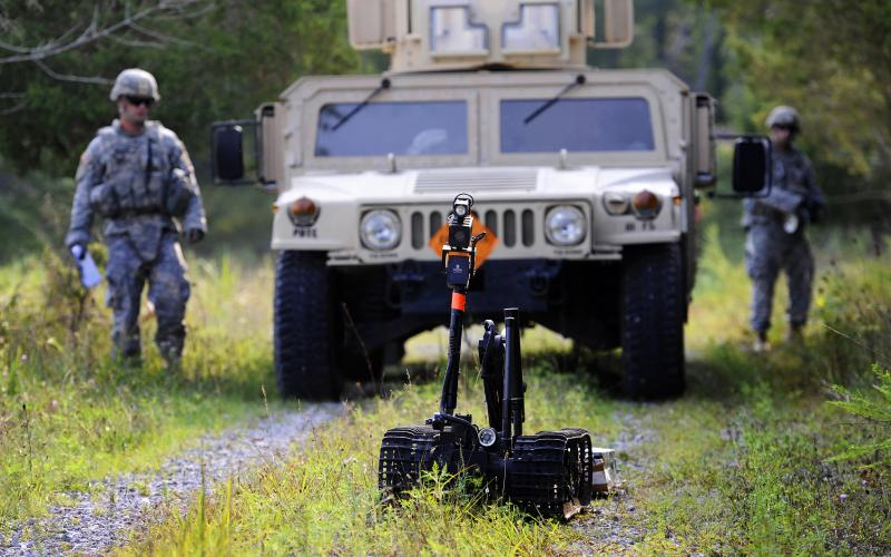 Soldiers train with a robot designed to counter improvised explosive devices. Army researchers have developed a prototype architecture that permits greater communication between man and machine through hand gestures.