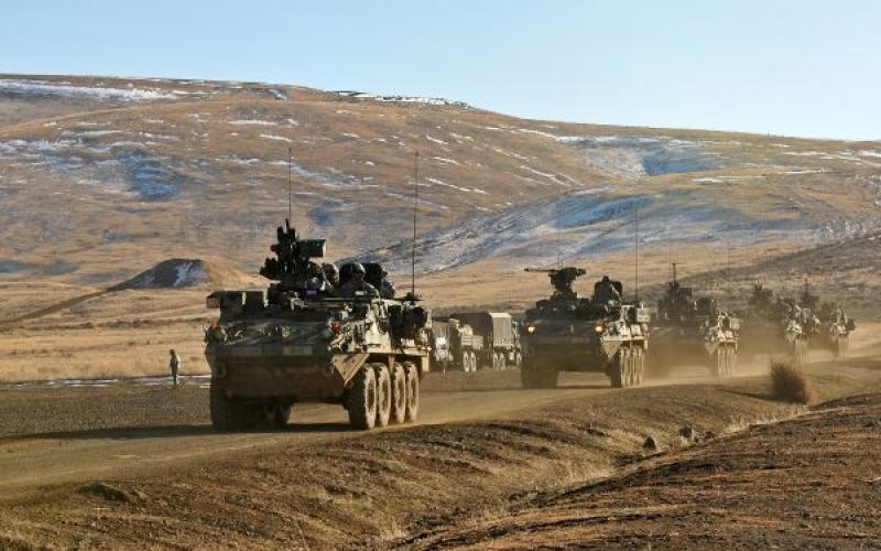 U.S. Soldiers aboard Stryker armored vehicles travel in a convoy past Range 5 in Yakima Training Center, Washington. The Army has seen significant cost savings on some versions of the Stryker vehicle through the Better Buying Power initiative.