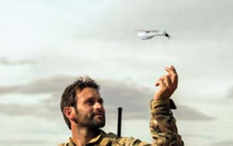 A NATO soldier launches a Prox Dynamics PD-100 nanocopter. The U.S. Army is using the system as a surrogate while developing the Cargo Pocket Intelligence, Surveillance and Reconnaissance system.