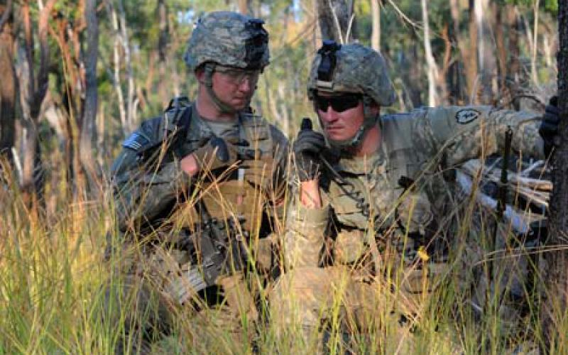 Two U.S. Army soldiers use a tactical radio during a training exercise in Australia. In the future, artificial intelligence could jam enemy radar signals and wireless communications or aid in electromagnetic spectrum management.