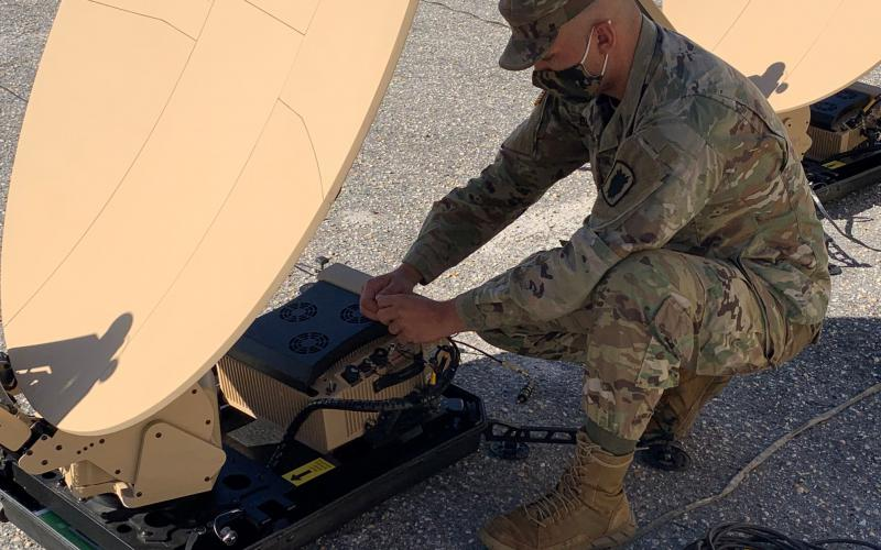 A Scalable Network Node operator with the 50th Expeditionary Signal Battalion-Enhanced connects cables to the Very Small Aperture Terminal modem during new equipment training at Fort Bragg, North Carolina. The new nodes are among the modernization equipment changing the way enhanced signal battalions will operate in the future.   U.S. Army photo
