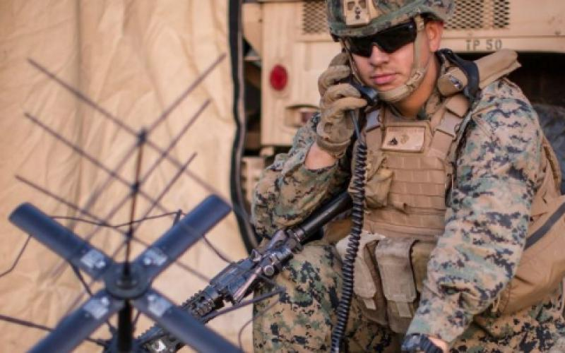 U.S. Marine Corps Cpl. Frankie Garcia, a radio chief with the 11th Marine Expeditionary Unit, calls for a radio check using a PRC-117G radio at Marine Corps Base Camp Pendleton, California. The Corps fielded a Mobile User Objective System waveform, which encompasses updated firmware to the AN/PRC-117G and an antenna kit to enhance satellite communication on the battlefield. Now, the military is developing elements of a new Fighting SATCOM architecture with some prototypical capabilities to be delivered late