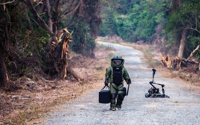 A U.S. Navy explosive ordnance disposal technician conducts counter improvised explosive device training with a robot during Cobra Gold 2016 in Thailand. Future warfighters may control robots, drones and cybersecurity systems with their brains without having neuro sensors surgically inserted. Navy photo by Petty Officer 2nd Class Daniel Rolston