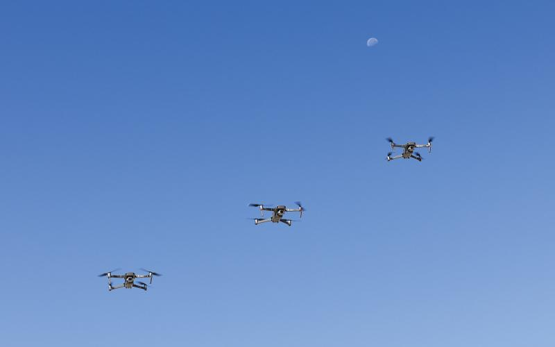 Three unmanned aerial systems fly at Edwards Air Force Base, California. Recent advances in neural implants may one day allow robots and unmanned vehicles to be operated directly from the brain. Credit: Air Force Staff Sgt. Rachel Simones