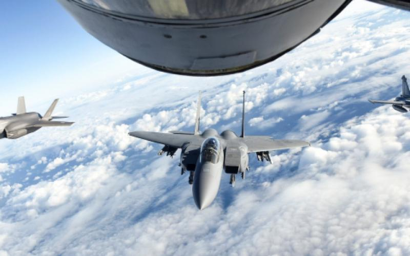 A U.S. Air Force F-15E Strike Eagle, center, a Royal Air Force F-35 Lightning II, left, and a French air force Dassault Rafale fly behind a U.S. Air Force KC-135 Stratotanker over the English Channel, during a November 2018 multinational training exercise. The Air Force is developing and fielding a new mission planning system for tankers using an agile software development methodology.  Photo by Air Force Senior Airman Luke Milano