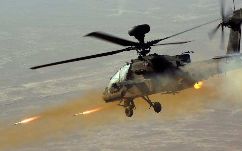 An Apache attack helicopter fires rockets at insurgents in Afghanistan. In the future, holograms and similar technologies may be used for training and educating warfighters as well as modeling weapon systems and platforms in development.