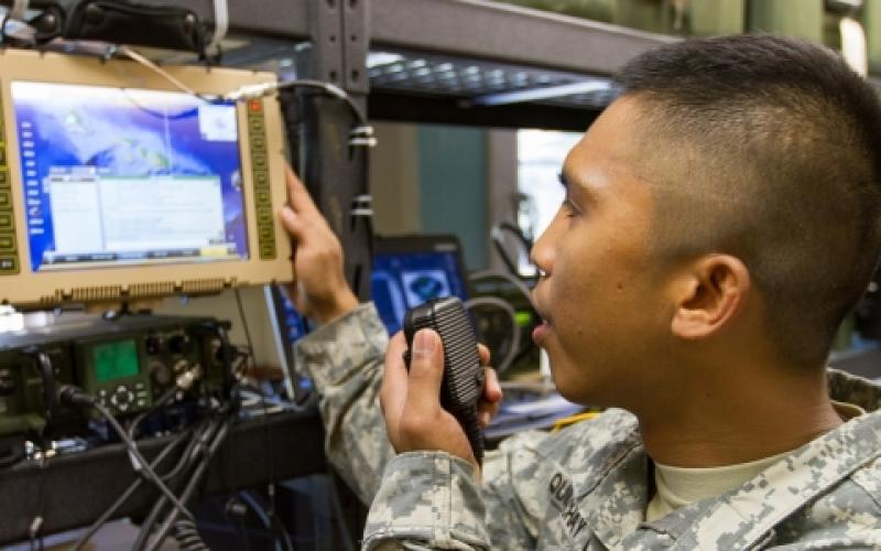 A 25th Infantry Division specialist conducts data and chat communications using a Mobile User Objective System (MUOS). The division's top signal officer says he wants to get his hands on a new industry-developed cross-banding solution that will improve interoperability between U.S. forces and Pacific Rim partners.