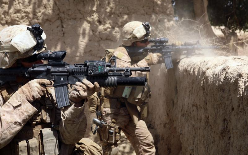 U.S. Marines fire their weapons during an operation in the Helmand province of Afghanistan. A deployed Marine requested the TechSolutions program develop a smart glass solution to allow warfighters to view situational awareness data without taking their hands off their weapons or their eyes off the battlefield.