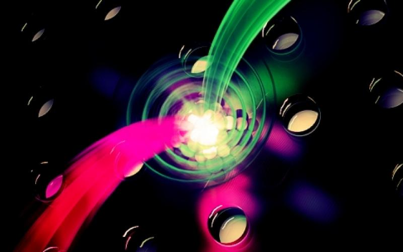 Scientists at the Joint Quantum Institute have created a crystal structure that boosts the interaction between tiny bursts of light and individual electrons, an advance that could be a significant step toward establishing quantum networks in the future.