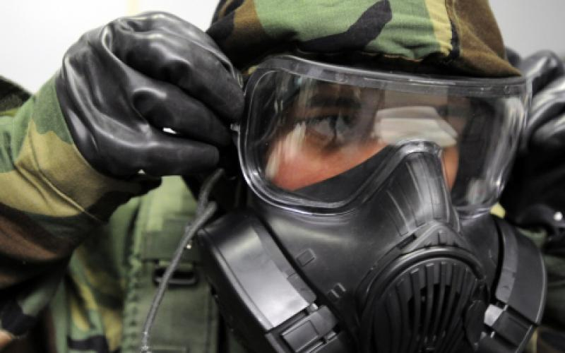 A senior airman removes his gas mask during a readiness drill. Because traditional biometric authentication techniques such as fingerprints and facial scans are not always practical for warfighters, Defense Information Systems Agency (DISA) officials are developing a prototypical system to track gait patterns and frequently visited locations.