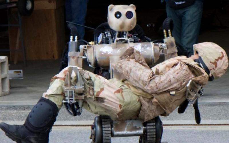 An all-terrain, search-and-rescue humanoid robot at Fort Detrick, Maryland, simulates how a soldier or item up to 500 pounds can be lifted and carried and how it can grasp fragile objects without damaging them. Unmanned systems of the future may be the first to encounter enemy fire.