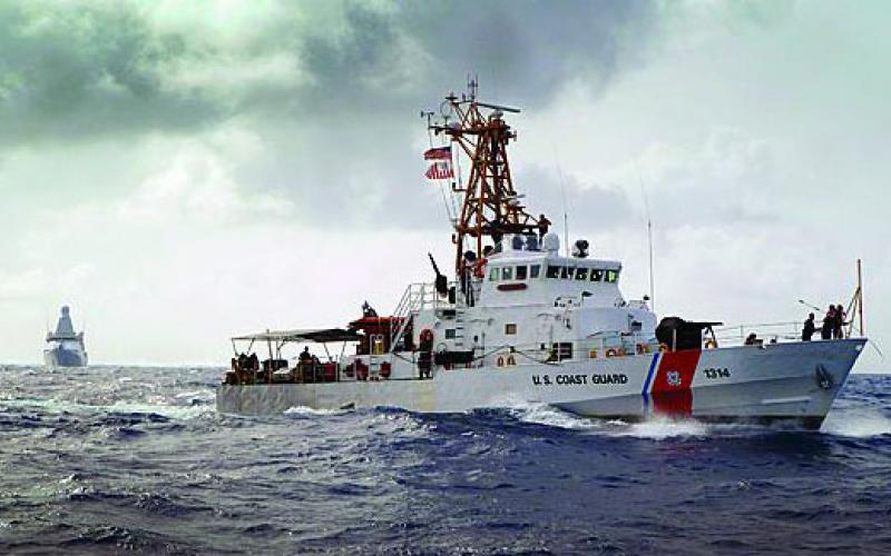 U.S. Coast Guard Cutter Sapelo and Royal Netherlands Navy Offshore Patrol Vessel HNLMS Holland search Caribbean Sea waters for bales of contraband. SeaWatch is the Coast Guard's next-generation command and control system for cutters.