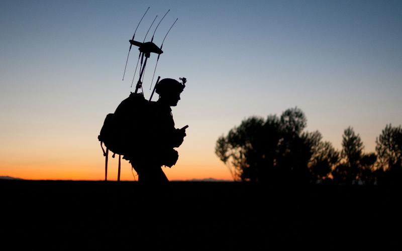 A U.S. paratrooper patrols as the sun rises in a village in Afghanistan's Ghazni province. Soldiers fighting in future coalitions may benefit from more advanced information systems and distributed analytics.