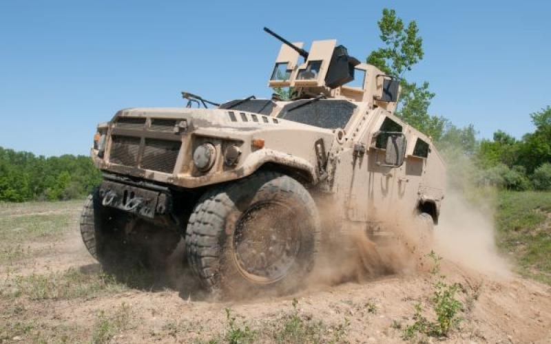 AM General's Joint Light Tactical Vehicle prototype negotiates the off-road demonstration course at the Transportation Demonstration Support Area in Quantico, Va. The yet-to-be-chosen platform is destined to carry the common VICTORY architecture for C4ISR and EW systems.