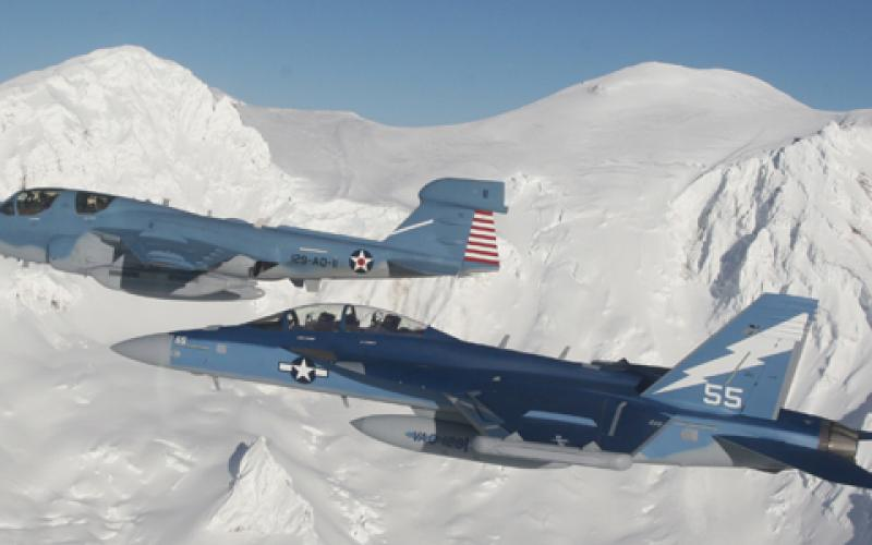 An EA-18G Growler (top) and EA-6B Prowler (bottom) fly together. The Navy is developing a next-generation jammer to be integrated onto the EA-18G, but Frank Kendall warns the United States is falling behind potential adversaries on electronic warfare systems.