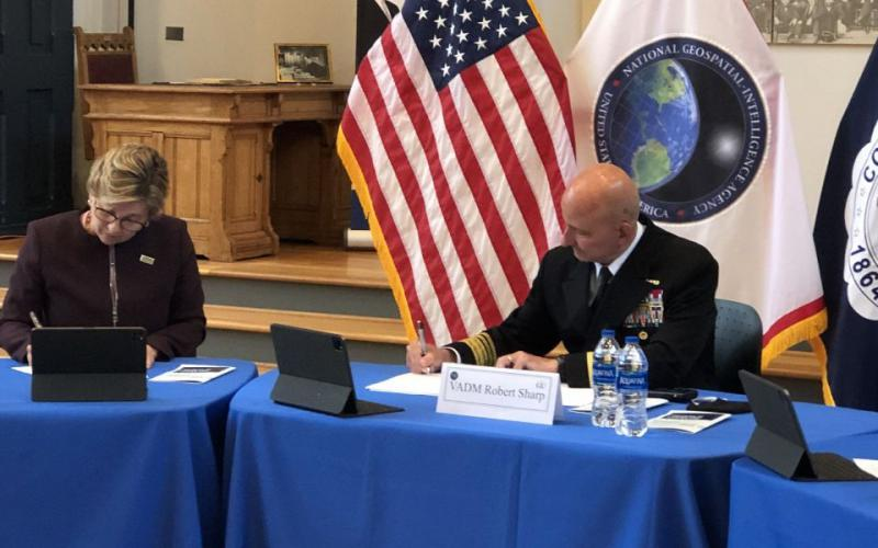 Vice Adm. Robert Sharp, USN (r), director of the National Geospatial-Intelligence Agency (NGA), and Gallaudet University President Roberta Cordano sign an education partnership agreement in May to increase research, engagement and recruiting opportunities in STEM. The agency's research directorate is expanding its partnerships with academia, the private sector and other government agencies to leverage innovation. NGA