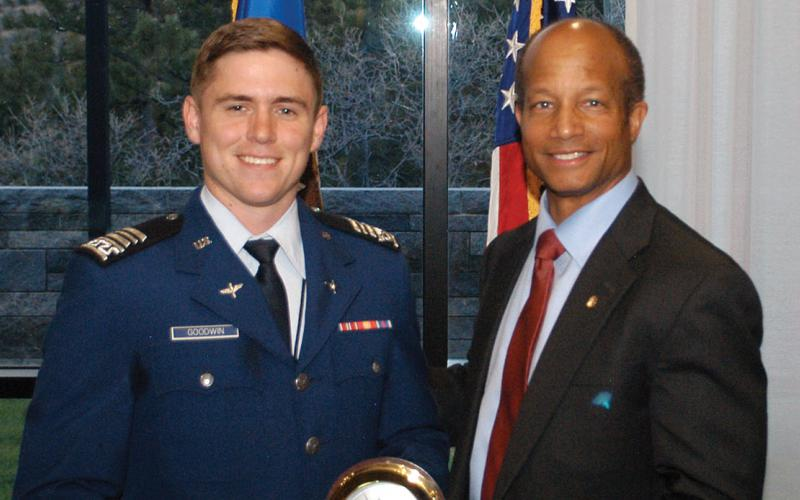 Cadet Jacob Goodwin (l), U.S. Air Force Academy, receives the Lt. Gen. Gordon T. Gould Jr., USAF, Honor Award from Col. Robert Wright, USAF (Ret.). This commissioning award at the Air Force Academy was named after Gen. Gould in 1983. He was an electronics engineer who graduated from the U.S. Military Academy in 1941 and was instrumental in enhancing the communications career field, giving it the recognition it deserved.