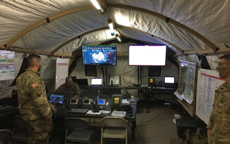 Currently, main command posts, commonly known as TOCs, still must be housed in tents until the U.S. Army can make the mission command systems smaller and mobile.  Photographer SGM Thomas Murphy