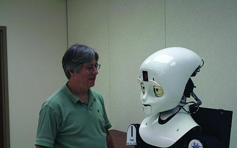 LASR director Alan Schultz engages one of the lab's humanoid robots in the Prototyping High Bay.
