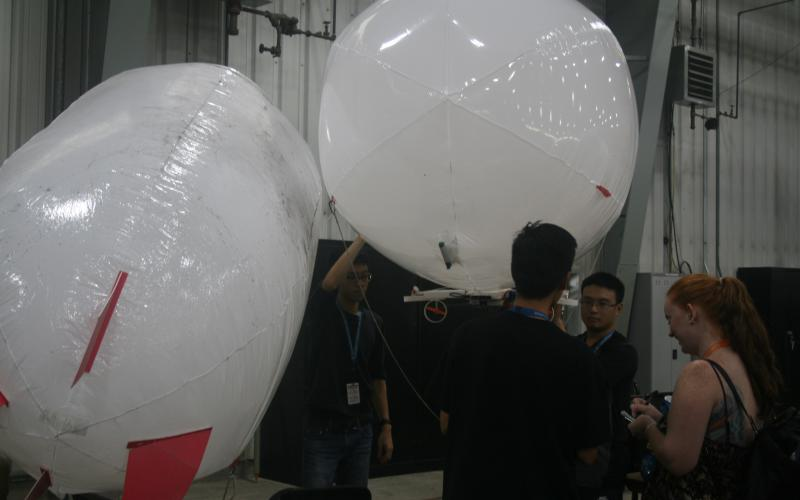 Team NCTU turns to airships, or blimps, for a longer running time compared to aerial drones.