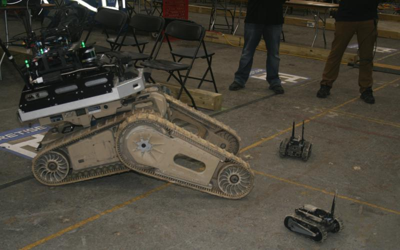 To extend its underground communications network, Team Cretise relies on a large tracked robot that carried a drone and mini robots into the mine.