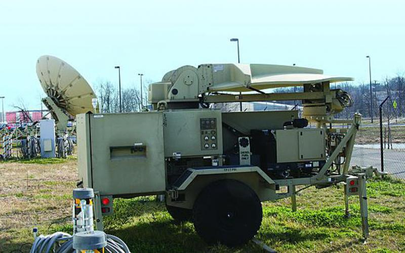 Tactical communications equipment line the field outside the facility housing the U.S. Army Communications-Electronics Command (CECOM) Joint On-demand Interoperability Network, or JOIN. This equipment allows JOIN to network diverse types of users in their own environment for massive joint testing and evaluation.