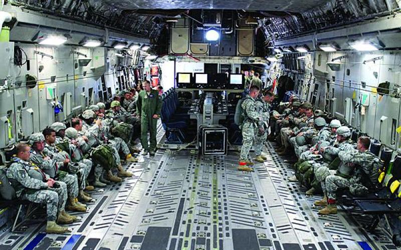 The full Joint Airborne Command and Control/Command Post (JACC/CP) system, which consists of four pallets with seats and work stations for as many as 16 users, sits in the cargo hold of a C-17 with soldiers deploying to a distant operation. Unlike the C-130, both ground troops (paratroopers) and battle staff can occupy the aircraft simultaneously with the JACC/CP.
