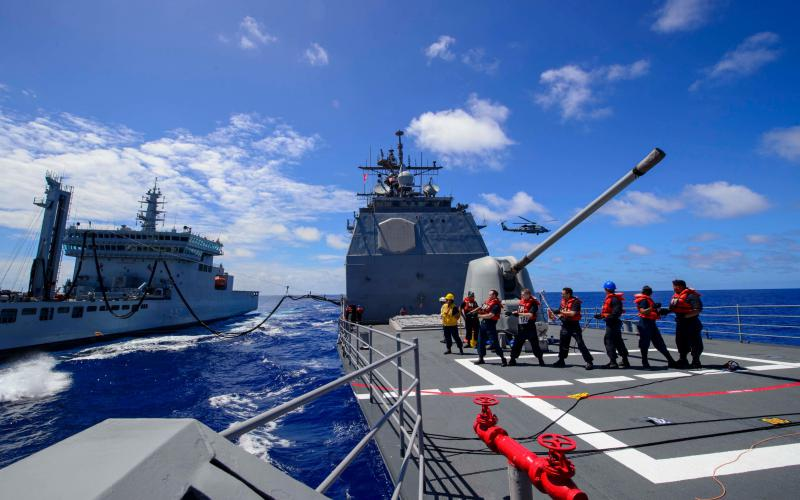 Sailors assigned to the Ticonderoga-class guided-missile cruiser USS Antietam conduct an underway replenishment training exercise with the Indian navy off the coast of Guam during exercise Malabar 2018, the 22nd such exercise and the first one hosted by Guam.  U.S. Navy photo by Mass Communication Specialist 2nd Class William McCann, 7th Fleet, U.S. Pacific Fleet