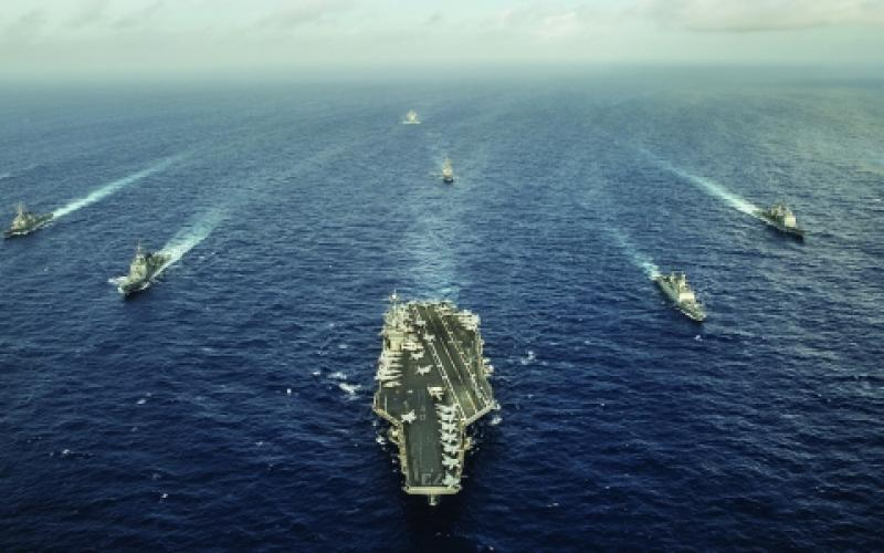 The aircraft carrier USS George Washington and ships from the U.S. Navy, the Indian navy and the Japan Maritime Self-Defense Force participate in trilateral naval field training. Carrier strike groups may be increasingly vulnerable to antiship missile systems and could be better protected with the use of an integrated electronic warfare capability.