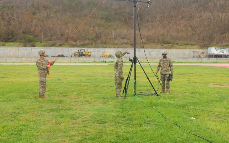 Soldiers from the 3rd Military Information Support Battalion set up an antenna to transmit text messages in St. Thomas. This helped get information to the Virgin Islands after Hurricane Irma hit.