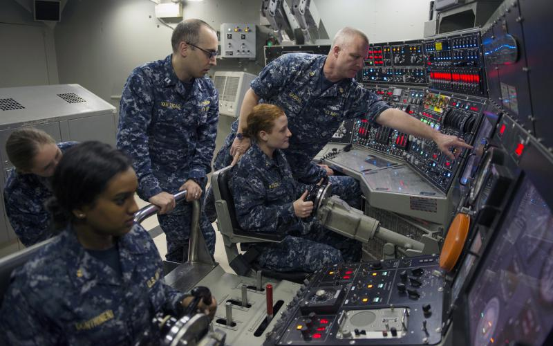 A group of Naval ROTC midshipmen practice driving a simulated submarine in the ship's control trainer at the Trident Training Facility in Bangor, Washington. The midshipmen toured the facility as part of their summer cruise to learn more about the Navy and their career options.