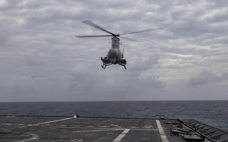 An MQ-8B Navy Fire Scout hovers over the flight deck of the Independence-variant littoral combat ship USS Montgomery in the South China Sea in January 2020. The Navy is exploring how to apply the Future Airborne Capability Environment, or FACE, open architecture to unmanned platforms such as the Fire Scout.  U.S. Navy photo by Mass Communication Specialist 2nd Class Chris Roys