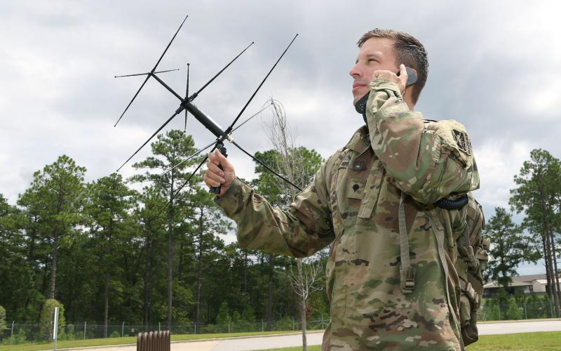 A student assigned to the U.S. Army John F. Kennedy Special Warfare Center and School, who is in the Special Forces Communications Sergeant course, uses an AV-2125 satellite antenna with an AN/PRC-117G satellite radio during training at the Yarborough Training Complex at Fort Bragg, North Carolina. Once qualified, students in the satellite communications module will be proficient in installing, operating and maintaining satellite communications links.  U.S. Army photo by K. Kassens