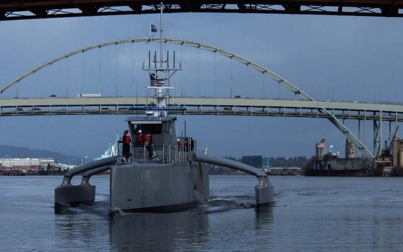 DARPA's Anti-Submarine Warfare (ASW) Continuous Trail Unmanned Vessel (ACTUV) prototype makes a dry run in Portland, Oregon. Officials christened Sea Hunter on Thursday.