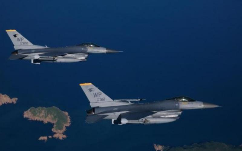 A pair of F-16 Fighting Falcons from the 80th Fighter Squadron, Kunsan Air Base, Korea fly to the range to practice procedures before an AIM-9 missile live fire exercise.