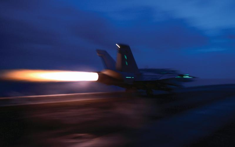 A U.S. Navy F/A-18C Hornet takes off from the USS John C. Stennis in the South China Sea. The Asia-Pacific region, home to dozens of nations with diverse relationships, may have its longtime peace and security disrupted by internal or external threats.