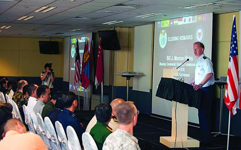 Brig. Gen. Mark Hicks, USAF, director of the J-6 at U.S. Pacific Command (PACOM), delivers remarks regarding the efforts of Pacific Endeavor 2012 at the end of the multinational exercise in Singapore.