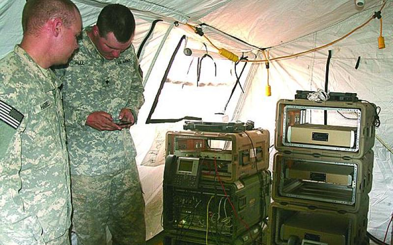 Soldiers from the 86th Expeditionary Signal Battalion evaluated the new command post 4G long-term evolution (LTE)/Wi-Fi system (network stacks) at the U.S. Army's NIE 14.2. (U.S. Army photo by Amy Walker, PEO C3T)