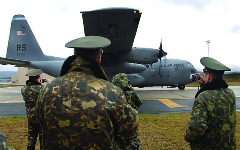 Russian air force officers take photos as a C-130 Hercules prepares for a combat offload demonstration at Ramstein Air Base, Germany. The United States must find ways to work with Russia ibecause of the latter's nuclear capabilities and position in the world.