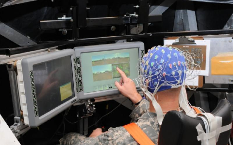 A soldier operates systems in a simulated tank while scientists at the Army Research Laboratory (ARL) monitor his brain waves. This work by the ARL's Combat Capabilities Development Center seeks to establish how artificial intelligence can be employed to address a soldier's needs by determining changes in the human's mood.  ARL photo