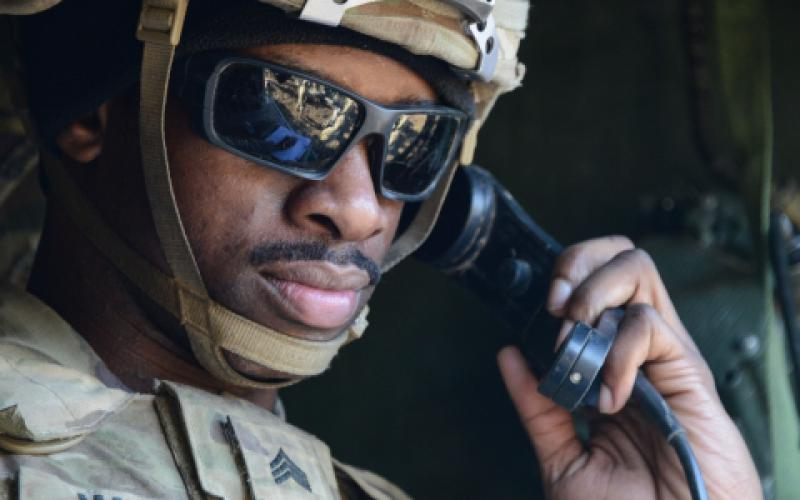 A U.S. Army sergeant communicates via radio on maneuvers in Germany. Army researchers are looking to incorporate new technologies into the service's communications network to be able to maintain information supremacy in future combat operations.  U.S. Army photo